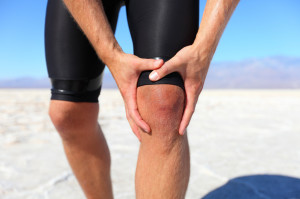 Injuries - sports running knee injury on man