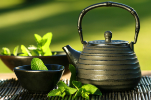 Black asian teapot with mint tea